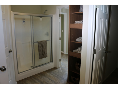 Separate shower and linen storage in master bath - St Martin T4529D by Palm Harbor Homes