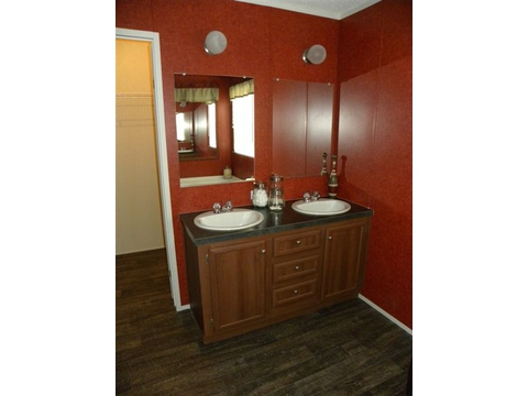 A better view of the dual vanities - - lots of space to move around! Lighting above each sink as well as separate cabinet space.  - The Canyon Lake TLF376X7 by Palm Harbor Homes