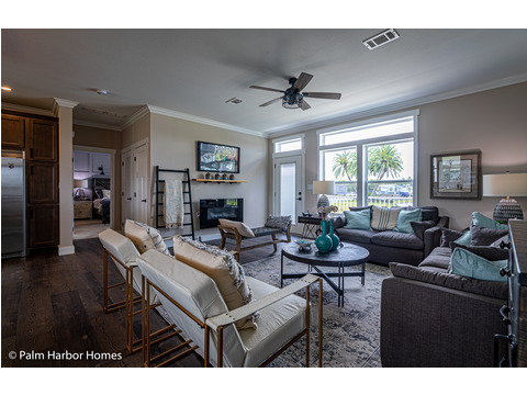 The primary living area in the Estate Farmhouse LS30764A 3 Bedrooms, 2 Baths, 2,280 Sq. Ft. – By Palm Harbor Homes – Available in Florida ONLY – Not Alabama, Georgia or Mississippi.