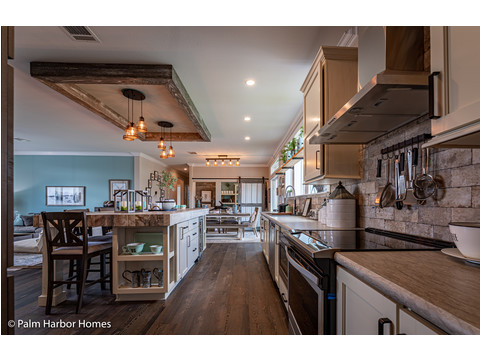 More great kitchen in the Estate Farmhouse LS30764A 3 Bedrooms, 2 Baths, 2,280 Sq. Ft. – By Palm Harbor Homes – Available in Florida ONLY – Not Alabama, Georgia or Mississippi.
