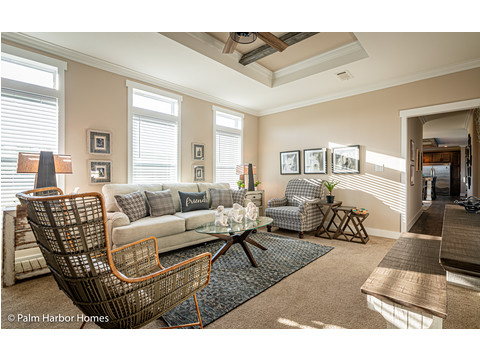 The family room in the Estate Farmhouse LS30764A 3 Bedrooms, 2 Baths, 2,280 Sq. Ft. – By Palm Harbor Homes – Available in Florida ONLY – Not Alabama, Georgia or Mississippi.