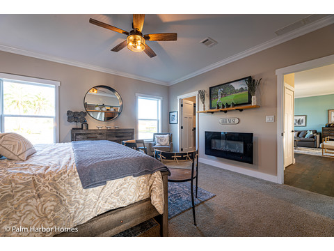 Electric fireplace in the Master bedroom of the Estate Farmhouse LS30764A 3 Bedrooms, 2 Baths, 2,280 Sq. Ft. – By Palm Harbor Homes – Available in Florida ONLY – Not Alabama, Georgia or Mississippi.