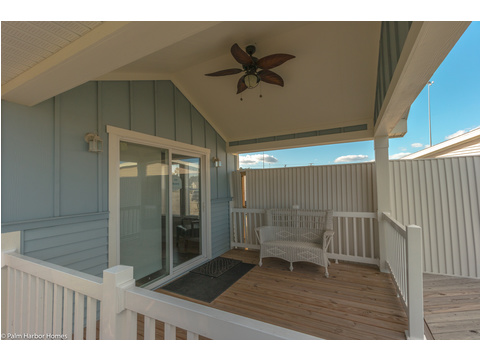 The porch on the Waverly LS15471A is the perfect place for summertime sitting and sipping under the cool breeze of the ceiling fan - 1 Bedrooms, 1 Baths, 555 Sq. Ft.