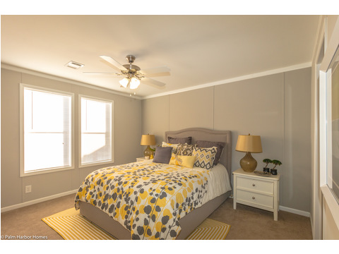 The master bedroom continues with the light and bright theme in the Monet II model manufactured home with 3 Bedrooms, 2 Baths, 1,173 Sq. Ft.  - 26.8' x 44' - in Florida.