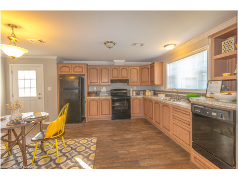 Lots of counter and storage space in the kitchen of the Monet II model manufactured home with 3 Bedrooms, 2 Baths, 1,173 Sq. Ft.  - 26.8' x 44' - in Florida.