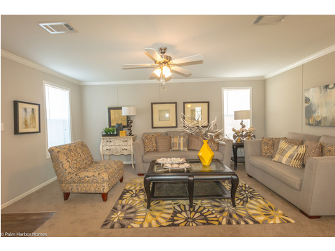 The living room is the perfect size for entertaining in the Monet II model manufactured home with 3 Bedrooms, 2 Baths, 1,173 Sq. Ft.  - 26.8' x 44' - in Florida.