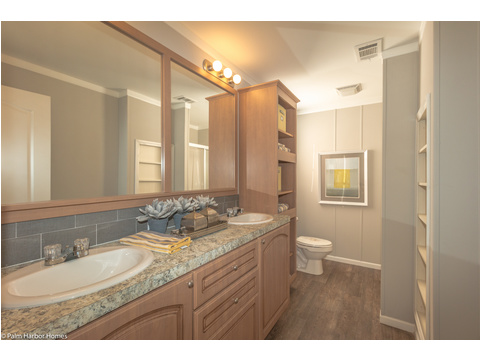 The master bath has double sinks, built-ins and more in the Monet II model manufactured home with 3 Bedrooms, 2 Baths, 1,173 Sq. Ft.  - 26.8' x 44' - in Florida.