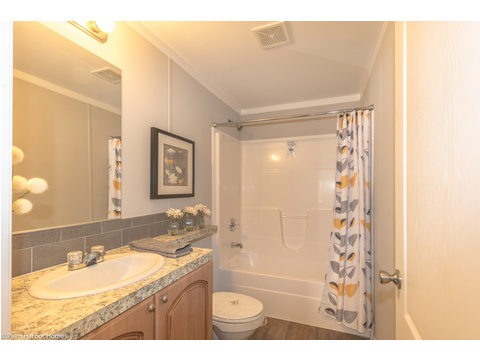 Secondary bathroom in the Monet II model manufactured home with 3 Bedrooms, 2 Baths, 1,173 Sq. Ft.  - 26.8' x 44' - in Florida.