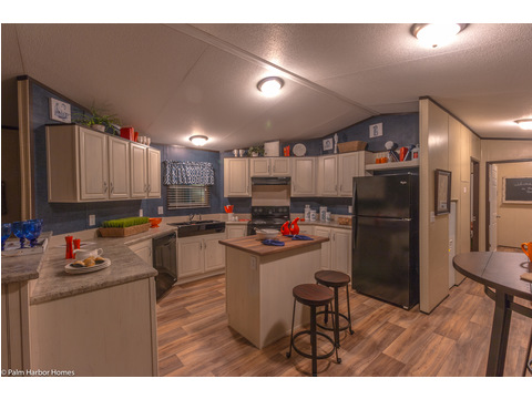 Nice island kitchen in the Horsesho Bay manufactured home available from Palm Harbor Homes