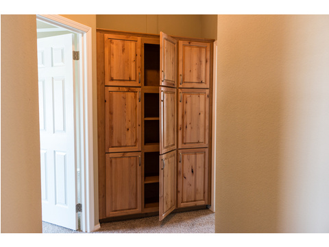 Need extra storage?  This wall of cabinets should help in our Bonanza manufactured home by Palm Harbor Homes - 3 Bedrooms, 2 Baths, 1,984 Sq. Ft.  - double wide home