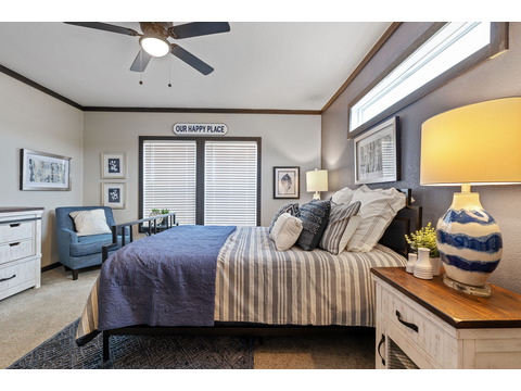 Master bedroom in The Horizon 30563Z by Palm Harbor Homes - 3 Bedrooms, 2 Baths, 1,680 Sq. Ft. Exterior Dimensions: 56 x 30 - This home available only in Louisiana, New Mexico, Oklahoma and Texas.