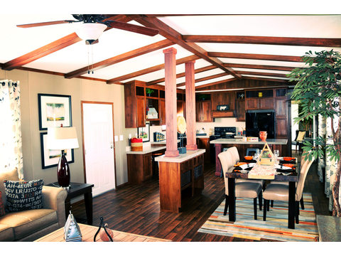 Absolutely stunning view from living room all the way to the kitchen! Check out the wood beams and wood lino floors!