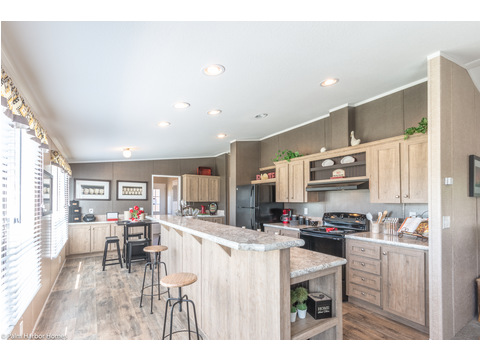 In fact, in the Heritage III, the entire kitchen is flooded with natural light from the windows behind the eat-in bar. Heritage Home III TLP360A5, 3 Bedrooms, 2 Baths, 1,640 Sq. Ft. - a manufactured home by Palm Harbor Homes.