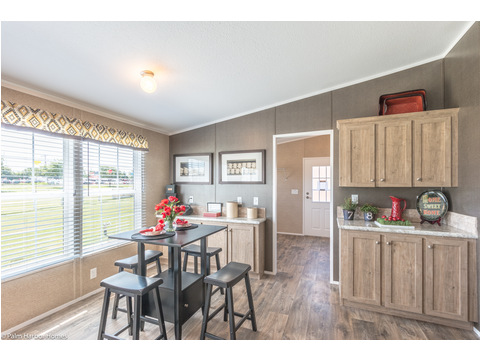 The Heritage III features a charming eat-in breakfast area with loads of sunlight and built-in storage. Heritage Home III TLP360A5, 3 Bedrooms, 2 Baths, 1,640 Sq. Ft. - a manufactured home by Palm Harbor Homes.