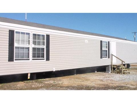 Model 16683V manufactured home with shutters and durable, easy-to-maintain siding from Palm Harbor Homes
