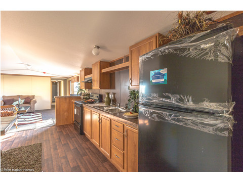 Anyone working in the kitchen is part of the action with this serving bar and open access to everything in the Model 16683V manufactured home with 3 Bedrooms, 2 Baths in 1,054 Sq. Ft. available from Palm Harbor Homes - www.palmharbor.com