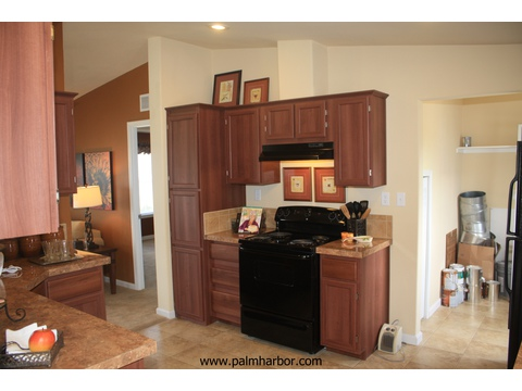 The Klamath - kitchen and utility room. Picture of home by manufactured/modular builder Palm Harbor.