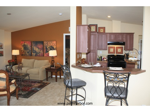 The Klamath - kitchen and living room. Picture of home by manufactured/modular builder Palm Harbor.