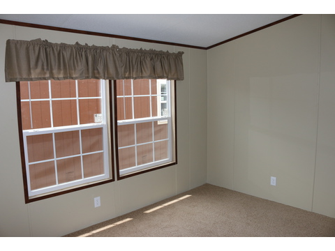 Spacious master bedroom with large windows allowing lots of natural light to shine in...