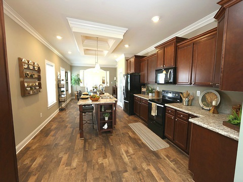 Kitchen from living room - The Buckeye II, 3 Bedrooms, 2 Baths, 3,145 Sq. Ft., modular Palm Harbor home built by Nationwide Homes