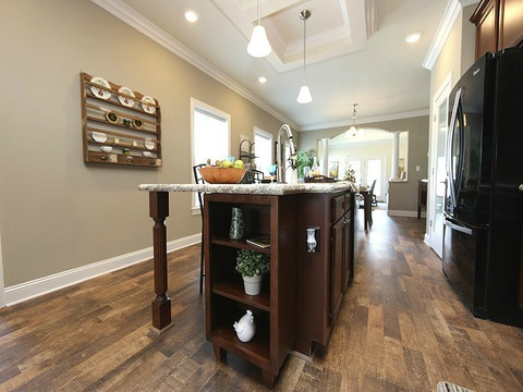 Beautiful custom shelving in kitchen island - The Buckeye II, 3 Bedrooms, 2 Baths, 3,145 Sq. Ft., modular Palm Harbor home built by Nationwide Homes