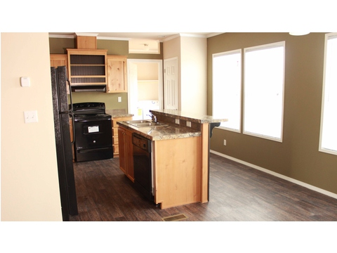 Move-in ready home in Pine Trace Community, Houston, TX - kitchen seen from dining area