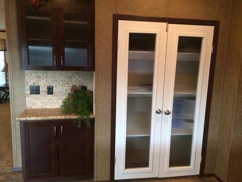 Kitchen pantry with glass door inserts - Pecan Valley V Extra Wide KHV476B2 or ML34764P by Palm Harbor Homes
