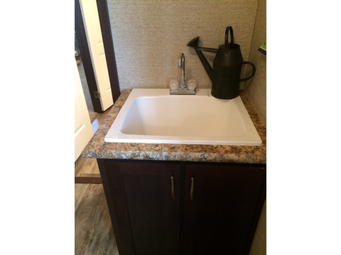 Deep tub sink in the spacious utility room - Pecan Valley V Extra Wide KHV476B2 or ML34764P by Palm Harbor Homes