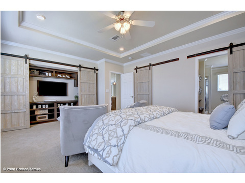 Master bedroom with one of the two walk-in closets turned into an on-demand entertainment center  - The Urban Homestead III FT32764F by Palm Harbor Homes