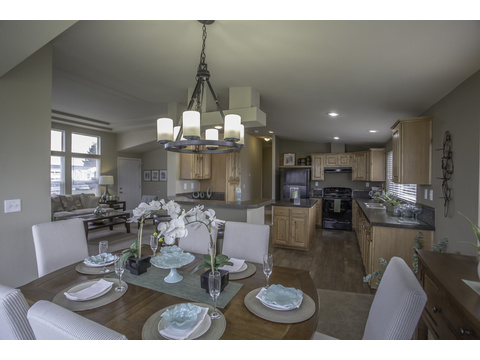 Dinning room and kitchen with living room in the far left - The Sunset Bay by Palm Harbor Homes