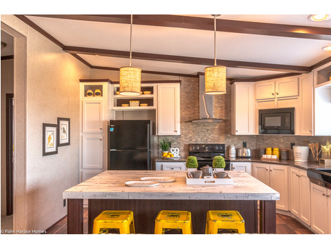 Beautiful and up-to-date details in the kitchen, including tile backsplash, solid countertop, custom cabinetry, farmhouse sink, and much more - The Arlington ML30523A by Palm Harbor Homes