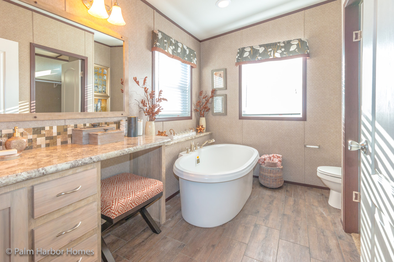 a circle investment has hers company jetted and deep his tiled vanities sold robinson master property the soaking bathroom inc shower tub private water closet stardance
