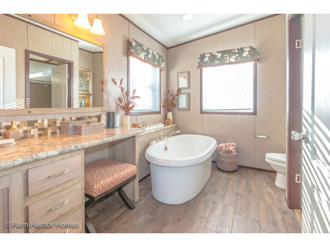 Beautiful free standing tub in Her Master Bath - the Lucky 7 Model II ML28724L Palm Harbor manufactured two section home - 4 Bedrooms, 3 Baths, 1,967 Sq. Ft.  Available in Louisiana, Mississippi, New Mexico, Oklahoma and Texas.