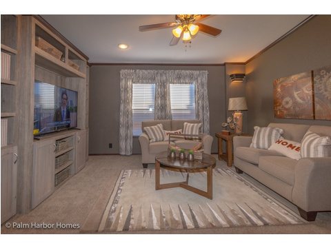 The family room doubles as a media room in the Lucky 7 Model II ML28724L Palm Harbor manufactured two section home - 4 Bedrooms, 3 Baths, 1,967 Sq. Ft.  Available in Louisiana, Mississippi, New Mexico, Oklahoma and Texas.