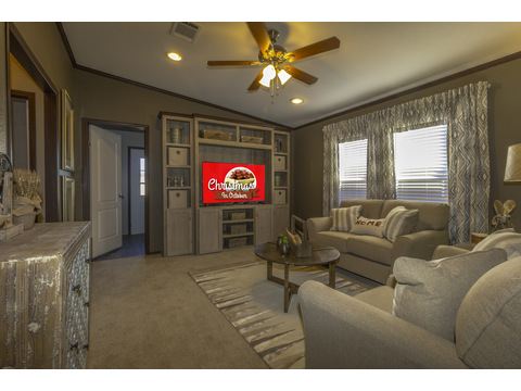 Great family room with built in entertainment center - The Lucky 7 Model II ML28724L manufactured two section home with 4 Bed, 3 Baths, 1,967 Sq. Ft. available in Louisiana, Mississippi, New Mexico, Oklahoma and Texas.   Exterior Dimensions: 72 x 28