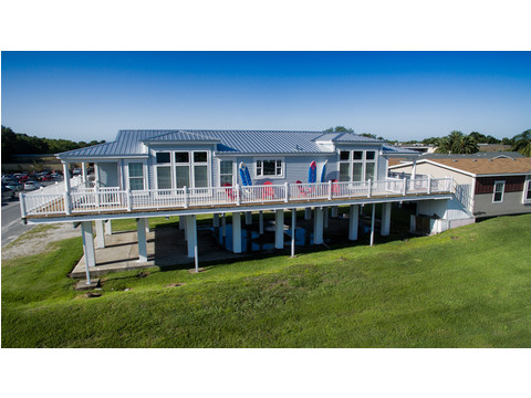 This Riviera model is shown elevated on pilings. Perfect for coastal lots for amazing 360 views! Available to tour at Palm Harbor location in Plant City, Florida. (Stilt pricing additional see model center)