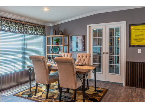 The open living area leads into the dining area.And this model illustrates the home office with french doors off the dining/master bedroom area! - The Pecan Valley III KHT368D5 by Palm Harbor Homes