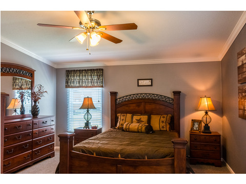 The large master bedroom provides a wonderful on-suite bath to round out this spacious master suite. - The Pecan Valley III KHT368D5 by Palm Harbor Homes