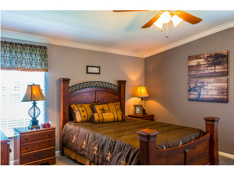 Split from the other bedrooms and baths, the large master bedroom provides plenty of room for a king size bed and side tables, dressers and a television area. - The Pecan Valley III KHT368D5 by Palm Harbor Homes