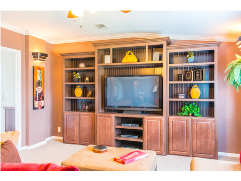 The den or theater room in the Pecan Valley III provides convenient access from the front living area as well as to the kitchen for a quick snack during half-time.