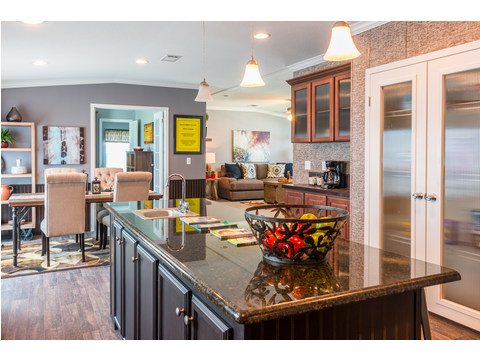 The large island provides great prep area, an eat-in bar feature, cookbook storage and be sure to ask about that gorgeous granite counter top! - The Pecan Valley III KHT368D5 by Palm Harbor Homes