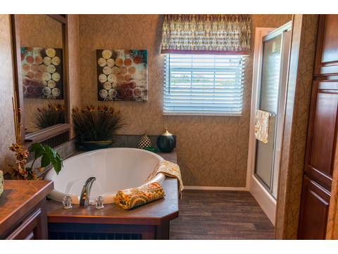 The large soaking tub with soak away the cares at the end of the day! And you will love the separate toilet room and the HUGE walk-in shower with easy-to-clean, durable ceramic tiles