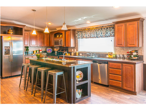 The spacious island kitchen is open to the eat-in dining area for great entertaining and family living - The Pecan Valley III KHT368D5 by Palm Harbor Homes