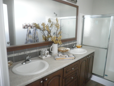 The Summer Haven master bath is large and open as well.  Clean lines of site and a HUGE walk-in shower on this Palm Harbor Homes model available in Florida and Alabama.