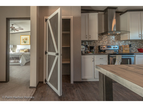 Charming rustic pantry door in the he Carrington 74 ML30744C - 2,220 square feet - 4 bedroom 2 bath - 2 living areas - 1 dining area - double wide manufactured home by Palm Harbor Homes - ask about our modular homes, too.
