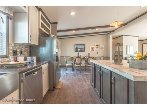 Lots of room around the kitchen island in the Carrington 74 ML30744C - 2,220 square feet - 4 bedroom 2 bath - 2 living areas - 1 dining area - double wide manufactured home by Palm Harbor Homes - ask about our modular homes, too.