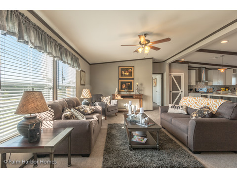 Living room to kitchen in the Carrington 74 ML30744C - 2,220 square feet - 4 bedroom 2 bath - 2 living areas - 1 dining area - double wide manufactured home by Palm Harbor Homes - ask about our modular homes, too.