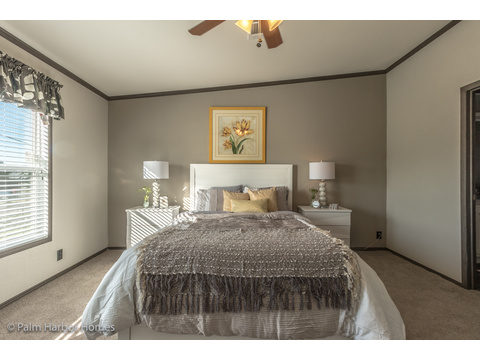 Master bedroom in the Carrington 74 ML30744C - 2,220 square feet - 4 bedroom 2 bath - 2 living areas - 1 dining area - double wide manufactured home by Palm Harbor Homes - ask about our modular homes, too.