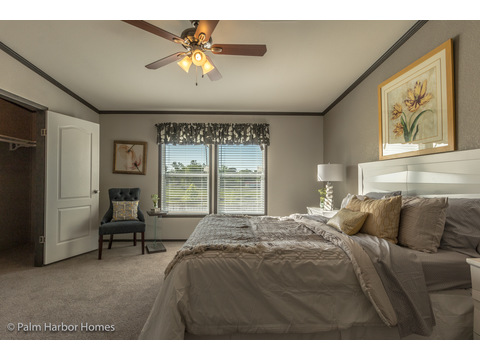 Master bedroom w/ walk in closet in the Carrington 74 ML30744C - 2,220 square feet - 4 bedroom 2 bath - 2 living areas - 1 dining area - double wide manufactured home by Palm Harbor Homes - ask about our modular homes, too.