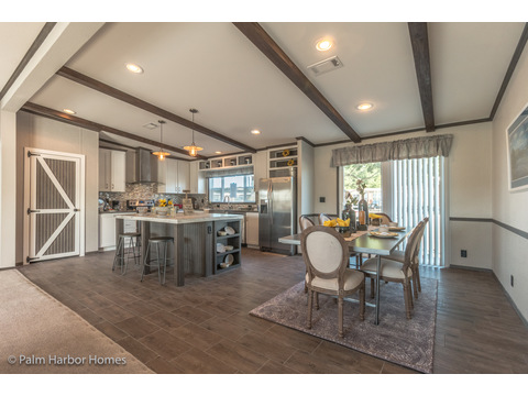 Open concept living area in the Carrington 74 ML30744C model home - 2,220 square feet - 4 bedroom 2 bath - 2 living areas - 1 dining area - double wide manufactured home by Palm Harbor Homes - ask about our modular homes, too.